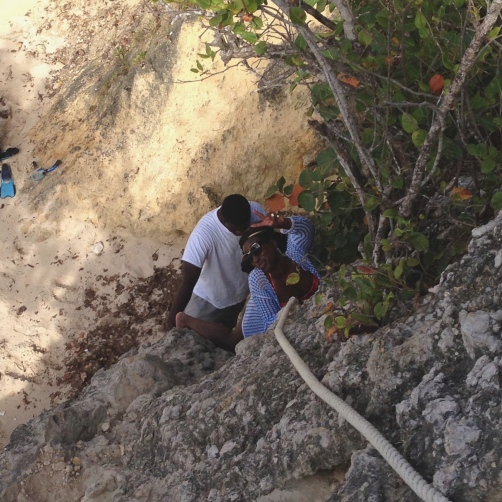 Climbing down to Little Bay Beach